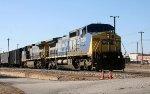 CSX 7728 & 9050 lead a train towards the yard