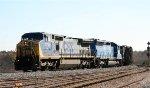 CSX 7710 leads a train towards the yard