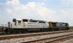 CSX 243 leads GCFX 3093 and a train towards Warmac