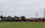 CSX 438 leads train Q471 into the yard as Q463 heads south