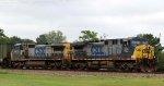 CSX 504 & 7676 lead train Q477-04 towards the yard