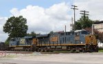 CSX 3203 leads train Q695-04 across Hamlet Avenue