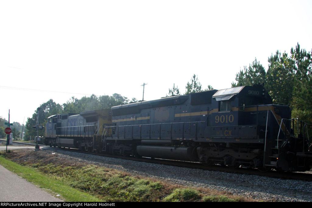 CSX 7815 leads a train towards the yard