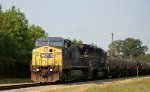 CSX 7915 leads a train toards the yard