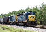 CSX 6904 & 2250 lead a train towards the yard