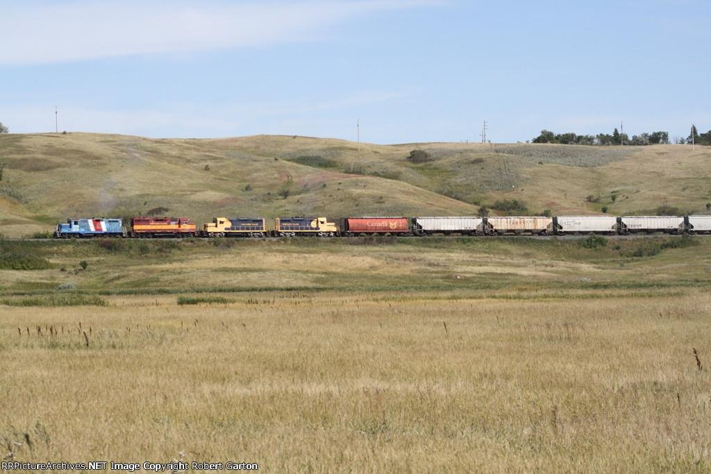 NPR 2285 Takes a Grain Train Amongst the Hills on the Former SOO Wheat Line
