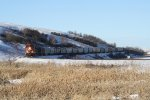 A Canadian Pacific Grain Train Snakes Along the Des Lacs River