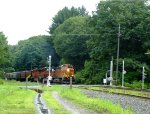 BNSF power leads grain empties westbound through Shelburne Falls