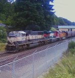 Colorful set of locos with a long load of grain