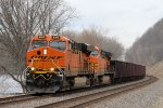 Eastbound BNSF #6317 pulling Taconite Cars. Also Getting a Nice Wave from the Conductor