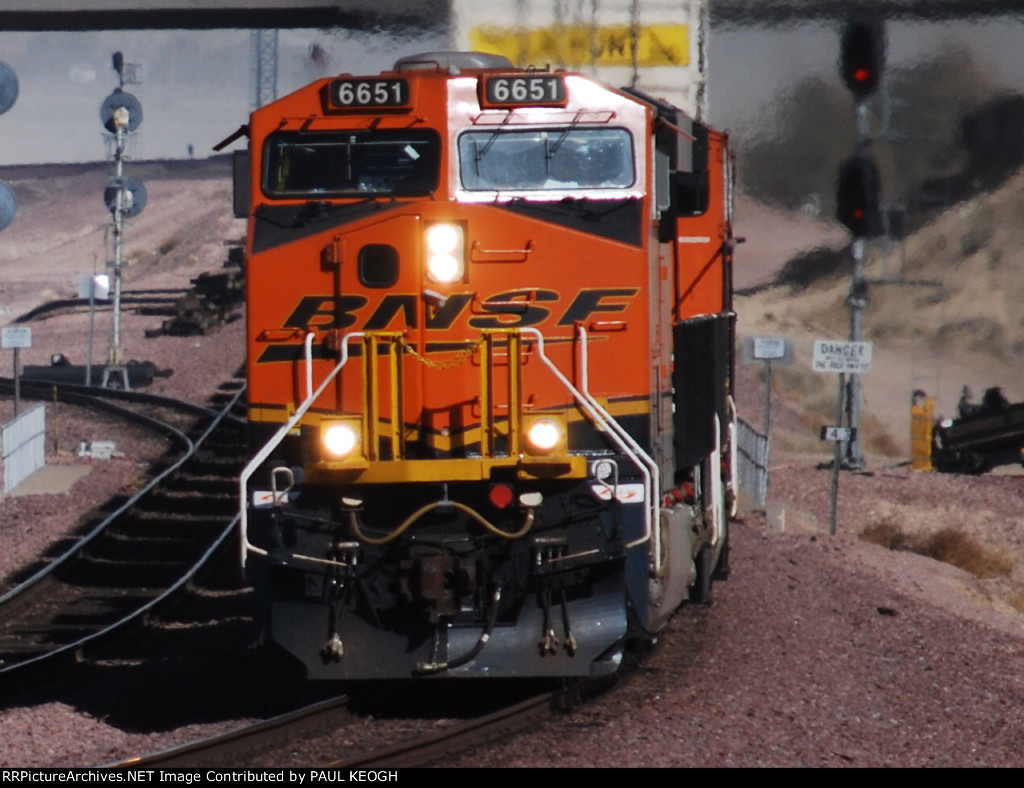 BNSF 6651 close in shot off her as the exhaust plume heat blurs the JB Hunt Intermodel container that is behind her.