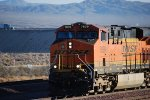 BNSF 7839 heads westbound as the Engineer blows her horn as I took this photo.