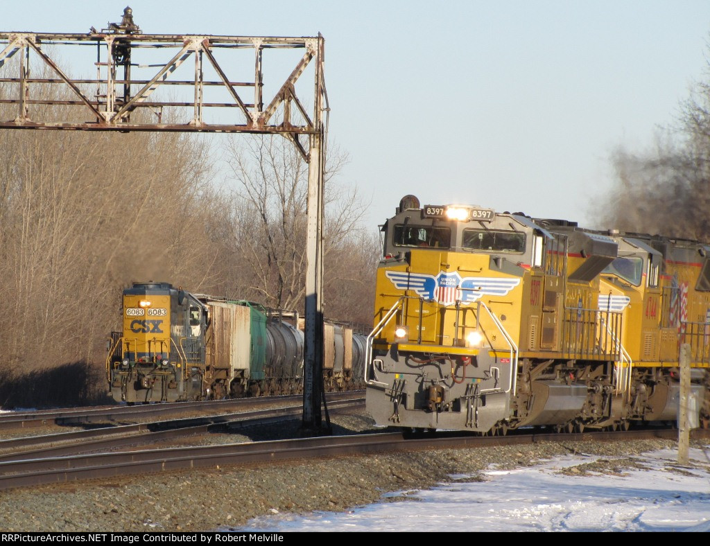 UP 8397 exiting the Westshore - local B791 with CSXT 6083 waits its turn to head back east