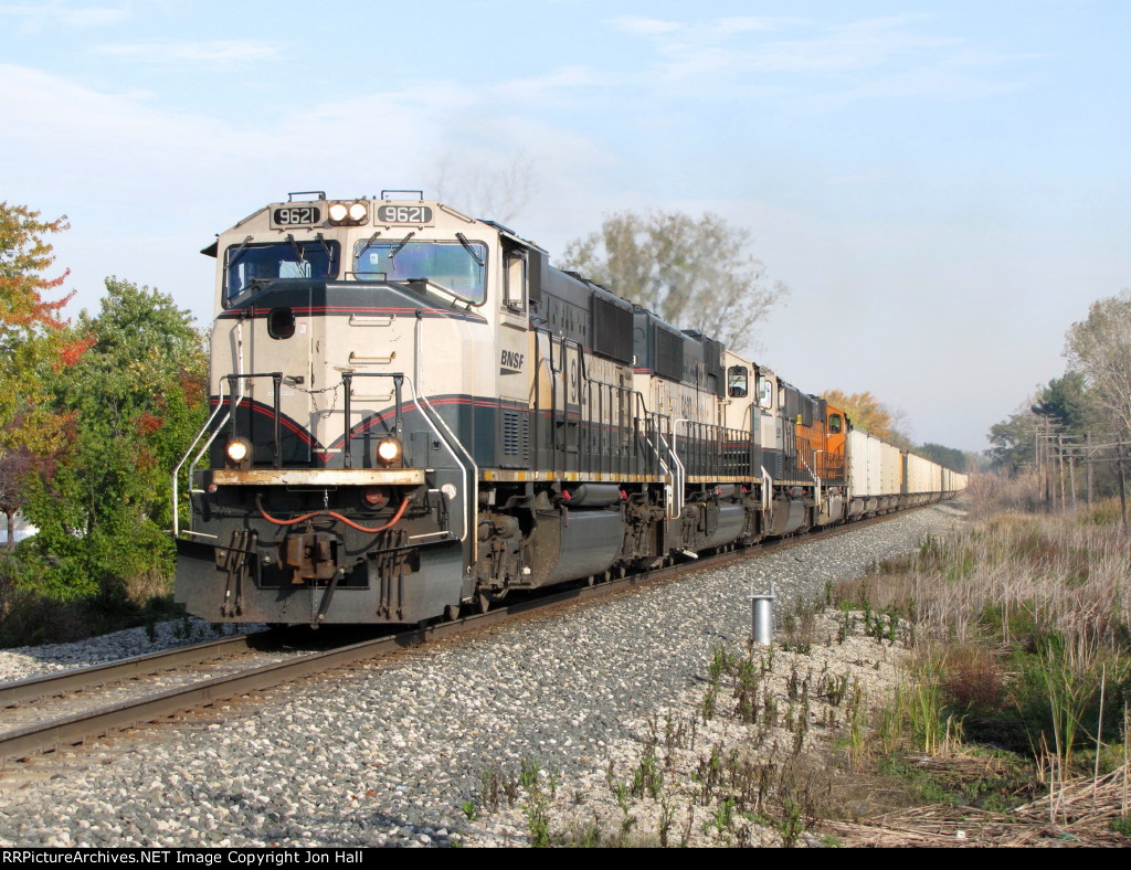 Picking up speed, BNSF 9621 leads E945-21 west on the Grand Rapids Sub