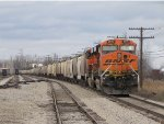 A grain train with BNSF power sits on the main at McGrew just after being delivered by the LSRC