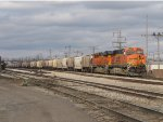 BNSF 5976 & 6268 sit on the main with Z144 and the grain train just off the LSRC