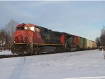 CN 2503 & 8863 sit next to milepost 99 with Q335-12