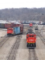 CN 2133 waits for its next assignment as two GP38's go about their work in the yard