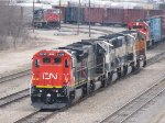 CN 2133 & IC 1011 sit with 3 BNSF SD70MAC's