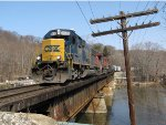 Its' work at Holland complete, Q335-18 heads west over the Kalamazoo River