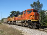 BNSF 9194 & 9852 ride along at the rear of northbound loads