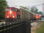 CN M393 Roars by the waiting L501 With GTW 5856.