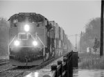 A lite snow falls a CN Q14921-29 rolls by Durand, with a pair of SD70M-2's.