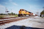 BNSF 5114 and BNSF 980 fly through town