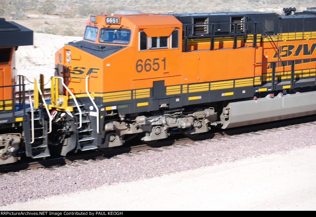 BNSF 6651 slows down as a #3 unit on a eastbound Z-Train for a crew change at the BNSF Barstow yard.