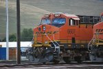 BNSF 6607 waits to roll westbound leading a manifest train with BNSF 5932 beside her.