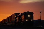 A Magnificient Californis Sunset backdrops the Arrival of BNSF 6622 as she slows down for the crewchange at BNSF Barstow yard.