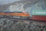 BNSF 6635 in Dynamic Braking as she heads west towards Los Angeles, Ca as a # 2 unit on this rainy morning in Cajon Pass.