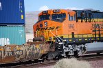 Zoom in shot of BNSF 6643 as she pushes a westbound Z as a rear lead DPU.