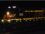 BNSF 6638 lights up her Reflective BNSF Swoosh Logo as she pulls a westbound Z-Train in this night Flash shot.