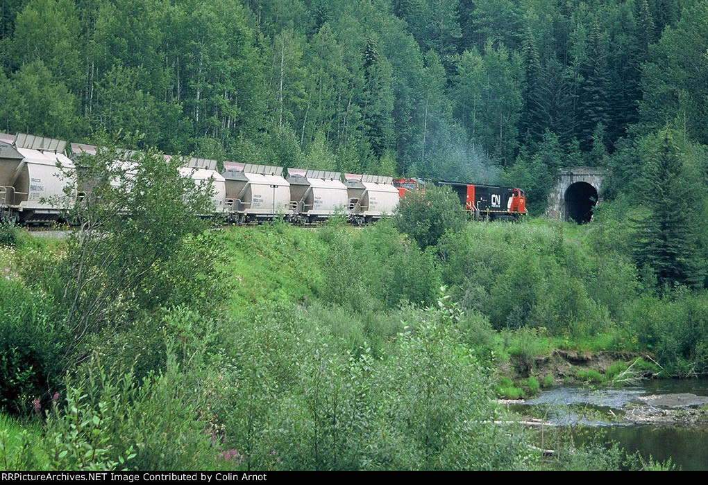 CN 5704 and 5777 enter Robb Tunnel on CN's Foothills Sub