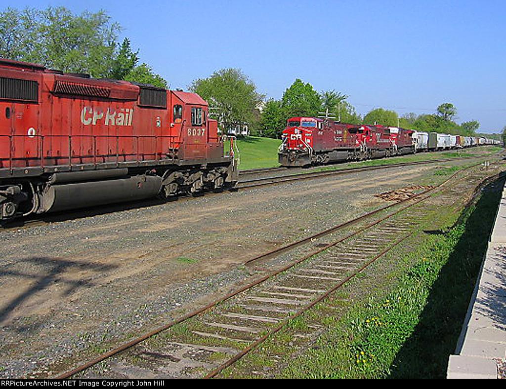 060508002 Westbound CP ballast train meets eastbound CP Manifest