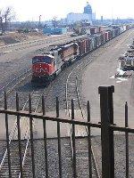 """060304001 WC Transfer rolls through BNSF Northtown """"T"""" Yard"""