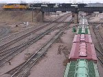 060401001 Westbound CP with UP and NS power crosses over BNSF Northtown Yard