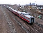 060401004 Eastbound Amtrak #8 passes BNSF Northtown Yard with private cars