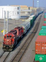 061123015 Southbound CP train passing BNSF Northtown Yard at CTC 44th Ave