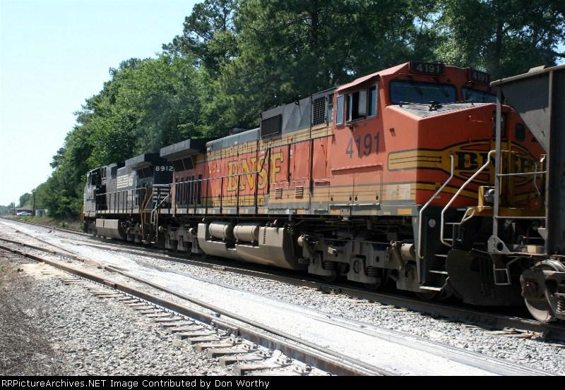 BNSF 4191 is 2nd unit of a hotshot string of empty hoppers on 5-20-06 speeding through Gordon