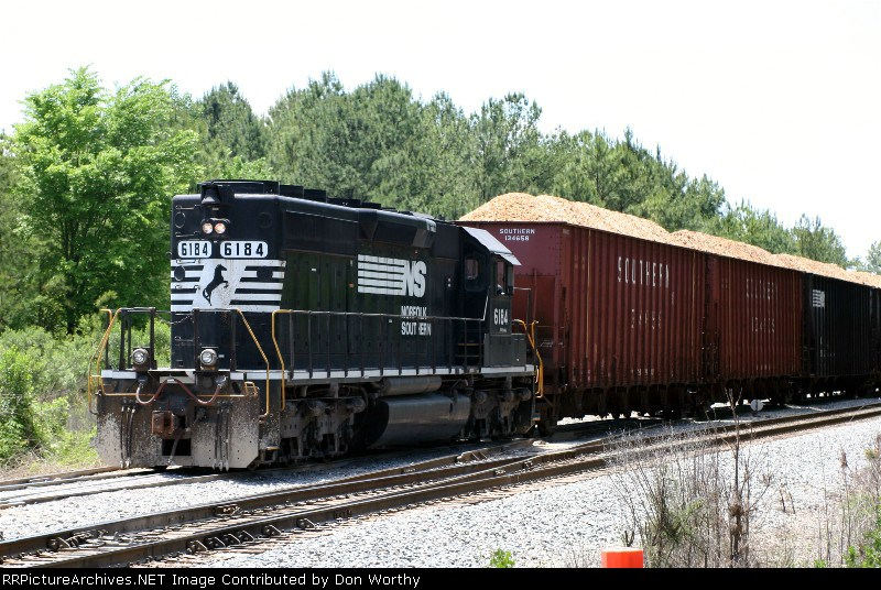 NS 6184 has a string of loaded woodchip hoppers on 5-12-06