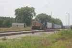 UP 4446 has a NS train east bound out of Gordon in August 06