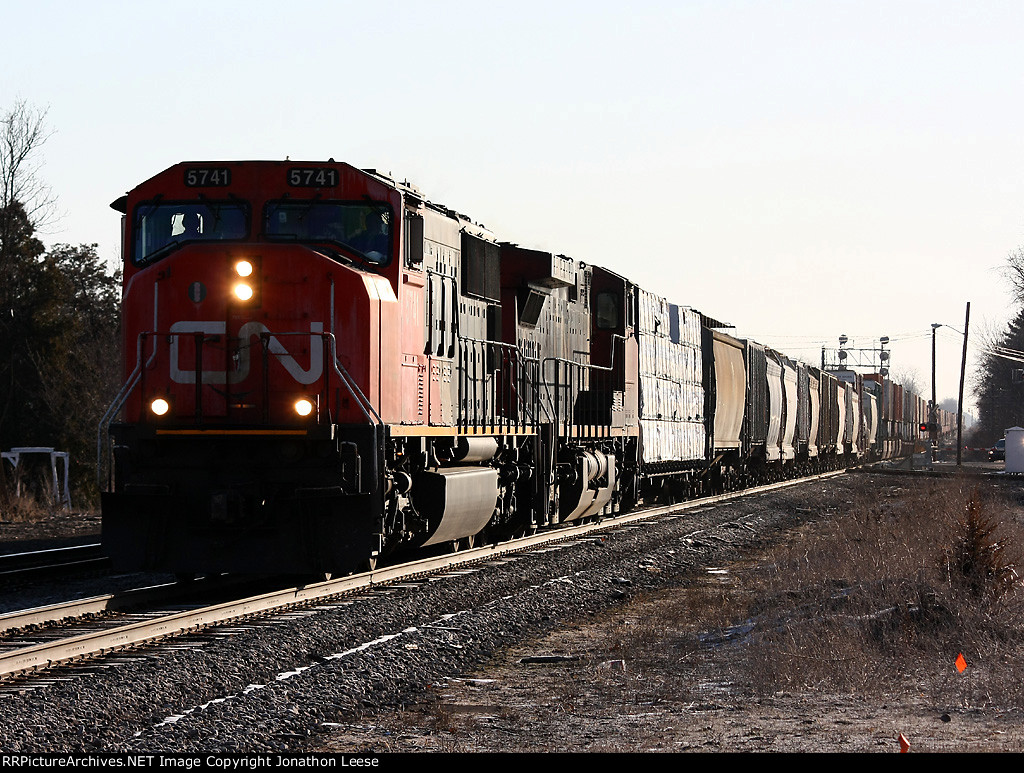 CN 5741 leads 149 west behind Amtrak