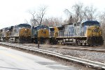 Q178 passing two parked coal trains along Hammonds Ferry Road