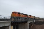 BNSF 8890, and 5891 push a BNSF Coal train north