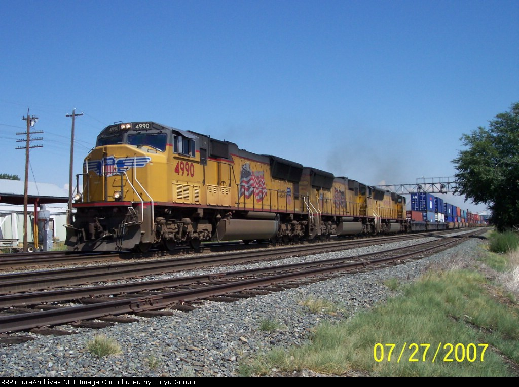 UP 4990 leads double stack train westbound
