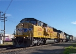 UP 2338 (SD60M) speeds west with auto racks