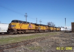 UP 5590 leads heavy UP train with loaded centerbeams