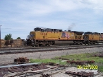UP 5604 leads westbound tie disposal train
